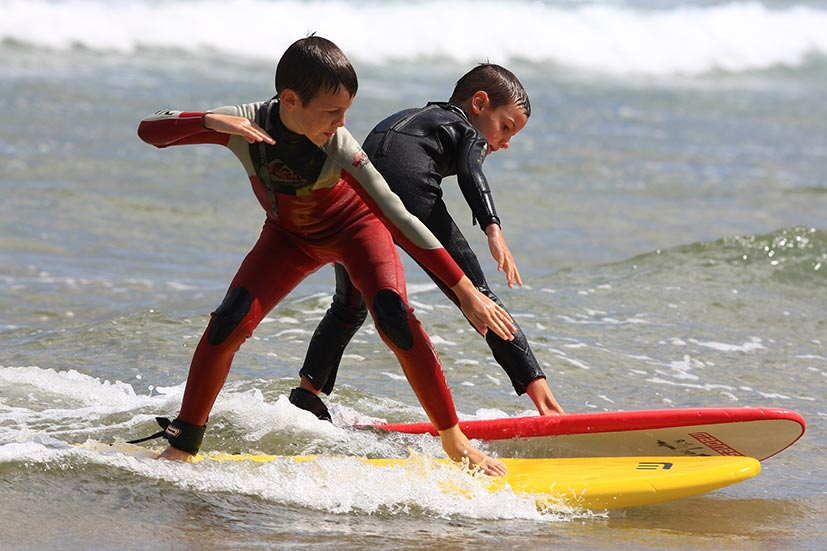 Kids surfing in Cantabria
